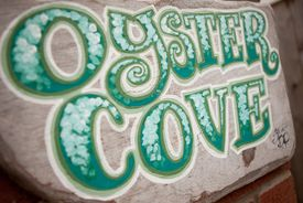 The Oyster Cove sign